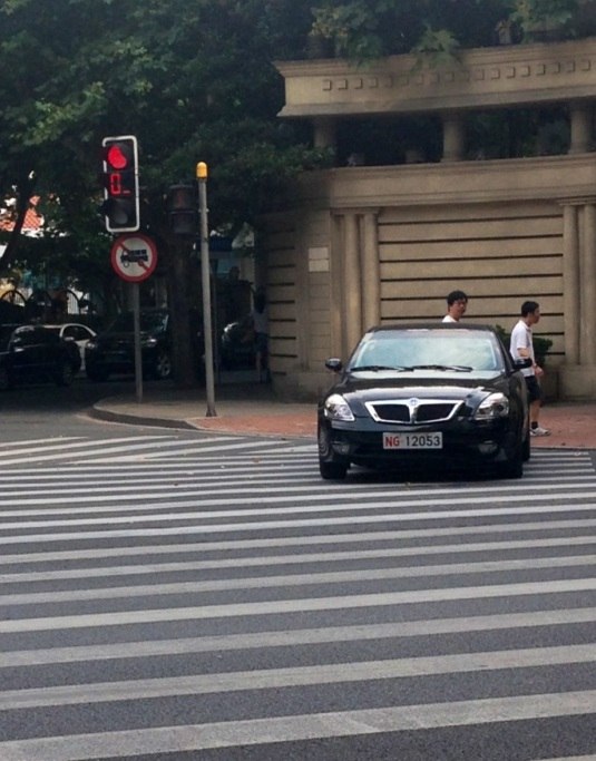 Is that a car driving along a crosswalk?